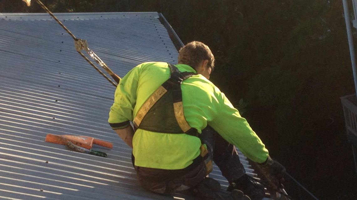 Gutter cleaning by roofer